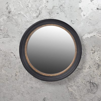 large round gold and black convex mirror