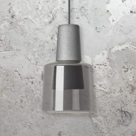 dark concrete fitting with a smoked glass shade
