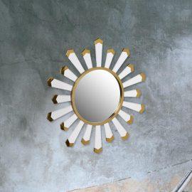 contemporary round white starburst mirror with gold detailing
