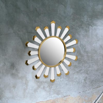 contemporary round white starburst mirror with gold detailing